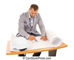 Architect working on a blueprint - Architect sitting at a...