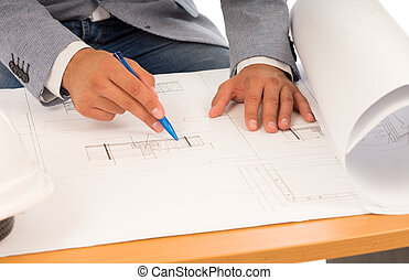 Architect or engineer checking a blueprint - Close up of the...