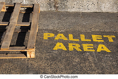 sign for wooden pallet area freight outside