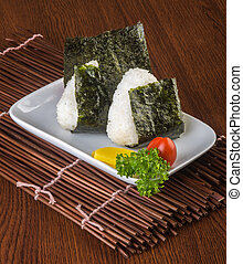japanese cuisine. onigiri or rice on the background -...