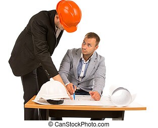 Architect discussing a plan with an inspector