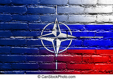 Nato and Russia Flag painted on brick wall