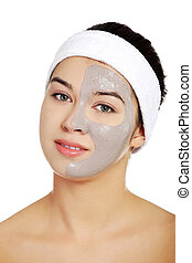 Relaxed woman with a nourishing face mask - Relaxed woman...