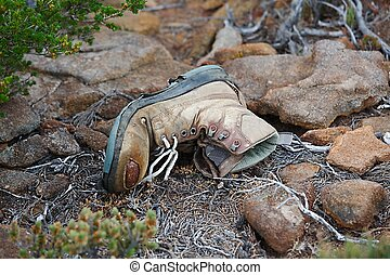 Old Boot - Torn hiking boot abandoned on the trail