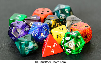 role playing dices lying on black background - stock photo