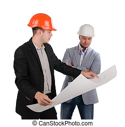 Two architects looking at a building plan