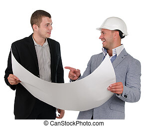 Architect discussing a blueprint with his partner as they...