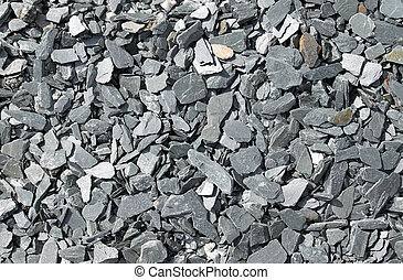 Gray broken slate stone abstract background.