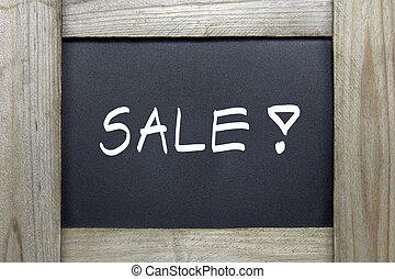 sale word on blackboard