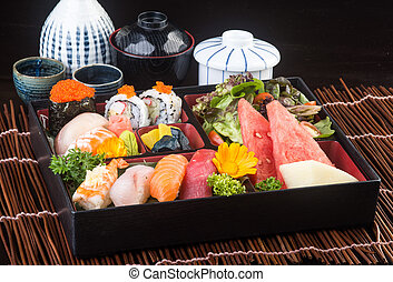 japanese cuisine. sushi set on the background - japanese...