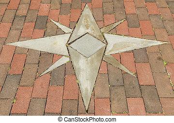 Star Design - Brick walkway with inlaid eight point star...