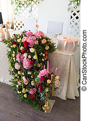 Floral arrangement to decorate the wedding feast, the bride...