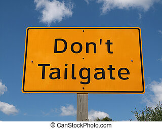 Dont Tailgate Sign - Dont tail gate highway sign on a bright...