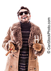 Having fun - a young man wearing a sheepskin coat isolated...