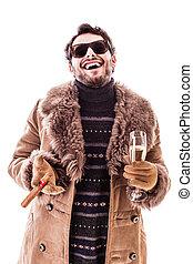 Having fun - a young man wearing a sheepskin coat isolated...