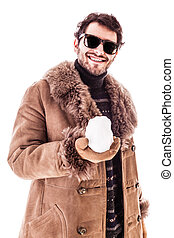 Snowball - a young man wearing a sheepskin coat isolated...