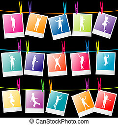 Series of children silhouettes on photo frames hanging on a...