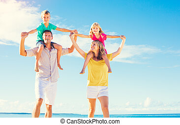 Family on the Beach - Happy Healthy Family of Four having...