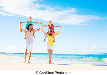 Family on the Beach - Family of four having fun on tropical...