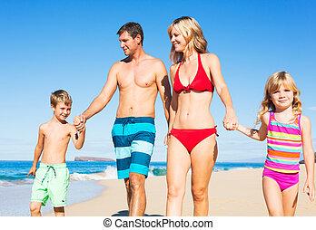 Happy Family at the Beach - Happy Family of Four Having Fun...