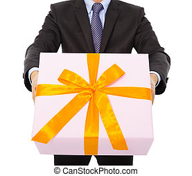 Businessman holding a gift box. isolated on white background