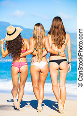 Beautiful Girls Having Fun Walking on the Beach - Group of...