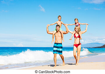Happy Family Having Fun on the Beach