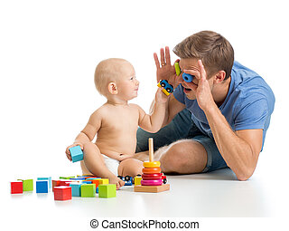 kid boy and father playing together