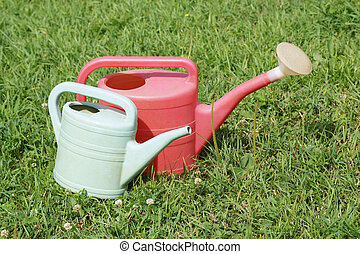 Two different sized watering can.