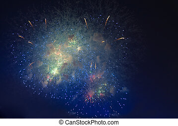 Fireworks in night dark sky with smoke after explosions