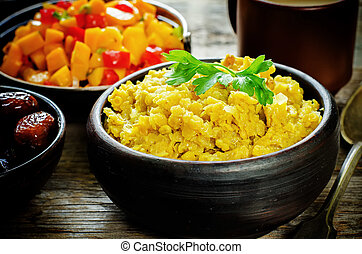red lentils with curry and dates and a salad of mango and...