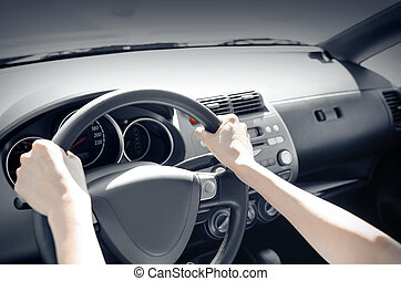 Car driver - Driver driving his car. Hands holding the...