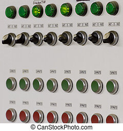 Control panel with buttons and levers