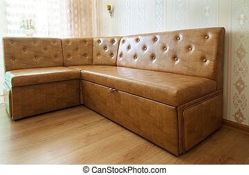 brown leather sofa in a room