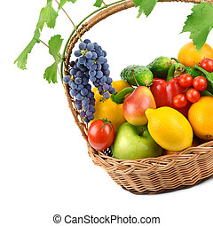 fruits and vegetables in a wicker basket isolated on white backg