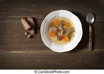 Soup - Fresh beef soup on wooden background overhead shoot