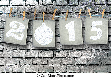 Snow-covered paper numbers of new 2015 with snow on abstract...