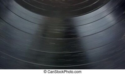 An old and worn record spinning - A very close view of an...