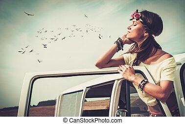 Hippie girl in a minivan on a road trip
