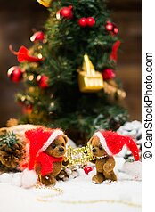 Small toy bears holding Merry Christmas sign in winter...