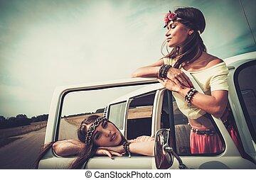 Hippie girls in a minivan on a road trip