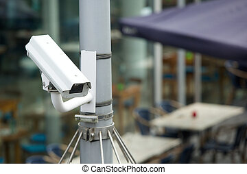 Security camera system attached to a pole outdoors