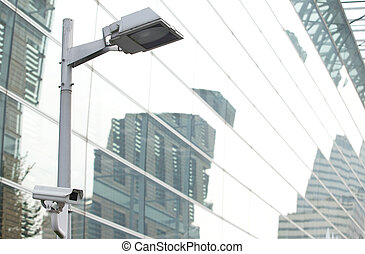 CCTV security camera lamp pole in the city - CCTV security...