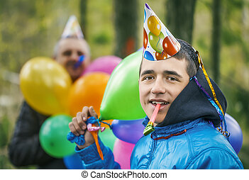 Boy with balloons in birthday party