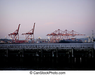 container port with cranes and ship in oakland california