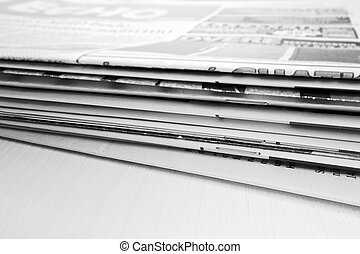 Newspaper on the wooden table