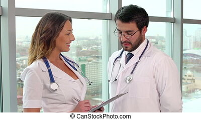 Professional Discussion - Close up of two medical workers...