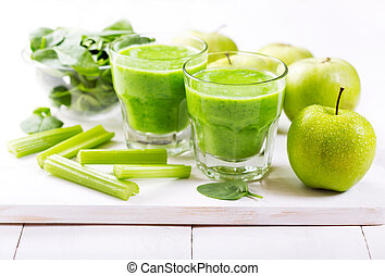 glasses of  green juice with apple and spinach
