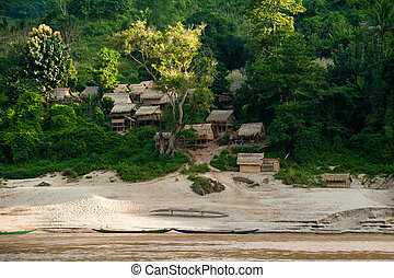 Small asian village with traditional wooden house in jungles...
