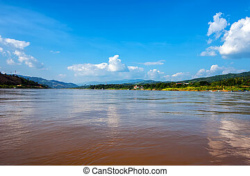 Panoramic view of Mekong river flowing between Laos on right sid